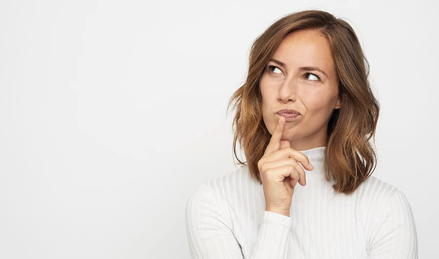 Photo of woman looking as if she's confused or in deep thought.